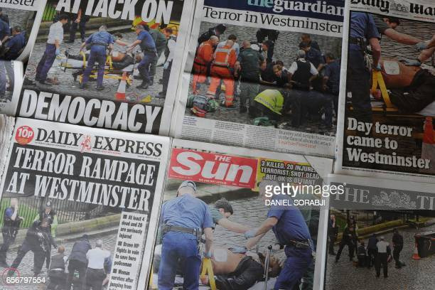 An arrangement of newspapers pictured in London on March 23 as an illustration shows the front pages of the UK daily newspapers reporting on the...