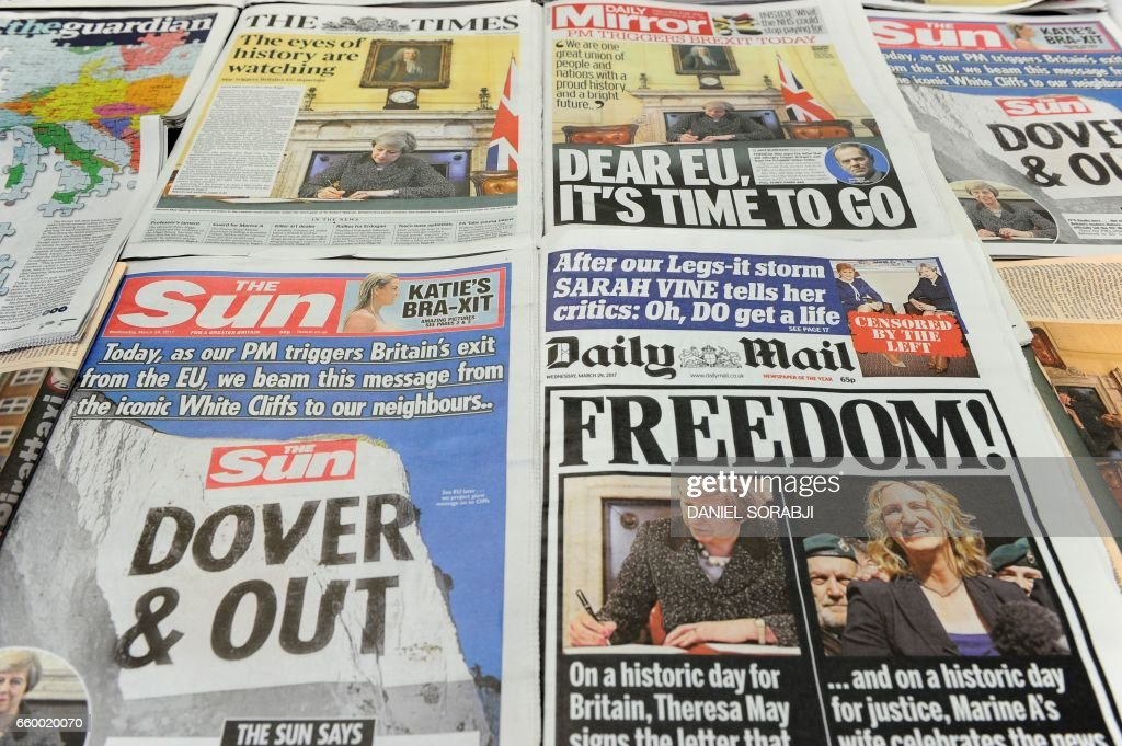 An arrangement of newspapers pictured in London on March 29, 2017, as an illustration, shows the front pages of the UK daily newspapers reporting on British Prime Minister Theresa May's signing of a letter to invoke the provisions laid out in Article 50 of the Lisbon Treaty to begin the process of Britain's withdrawl from the European Union (EU). Gleeful Brexit-backing newspapers raised a toast March 29 to Britain's serving notice on its EU membership, while their continental European counterparts struck a tone of lament, with one insisting 'it's not too late' to think again. SORABJI