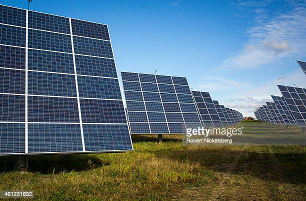 An array of 366 solar tracking devices stand in a field October 31 2014 in South Burlington Vermont Claire Solar Partners LLC company a Vermont...