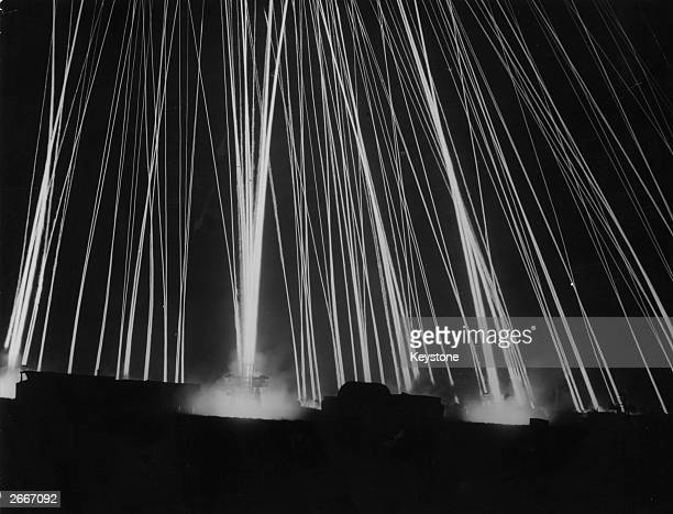 An array of army searchlights illuminate the night sky over London in the hope of spotting enemy aircraft during World War II