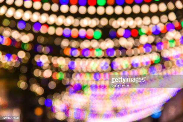 An array of colourful fairy lights are hung above a busy pedestrian shopping street in Causeway Bay Hong Kong