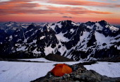 An array of peaks and glaciers that last all year remind climbers of the Alps looking south from Sahale Glacier Camp during sundown July 2008 in...