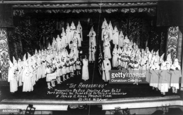 An array of robed masked Knights of the Ku Klux Klan appear on stage in 'The Awakening' presentation by Dick Downling a James H Hull Production June...