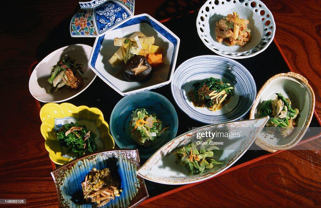 An array of Sansai ryori (mountain vegetables) from the Ichinomata Keikoku Onsen hotel on the upper Shimantogawa River.
