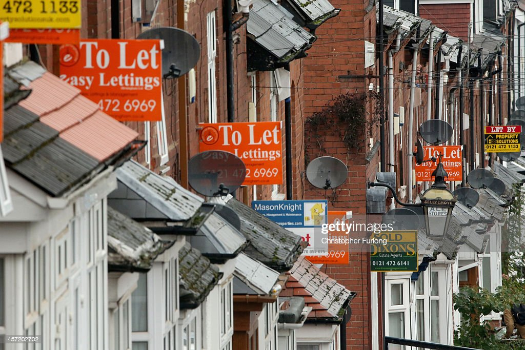 An array of To Let and For Sale signs protrude from houses in the Selly Oak area of Birmingham on October 14 2014 in Birmingham United Kingdom The...