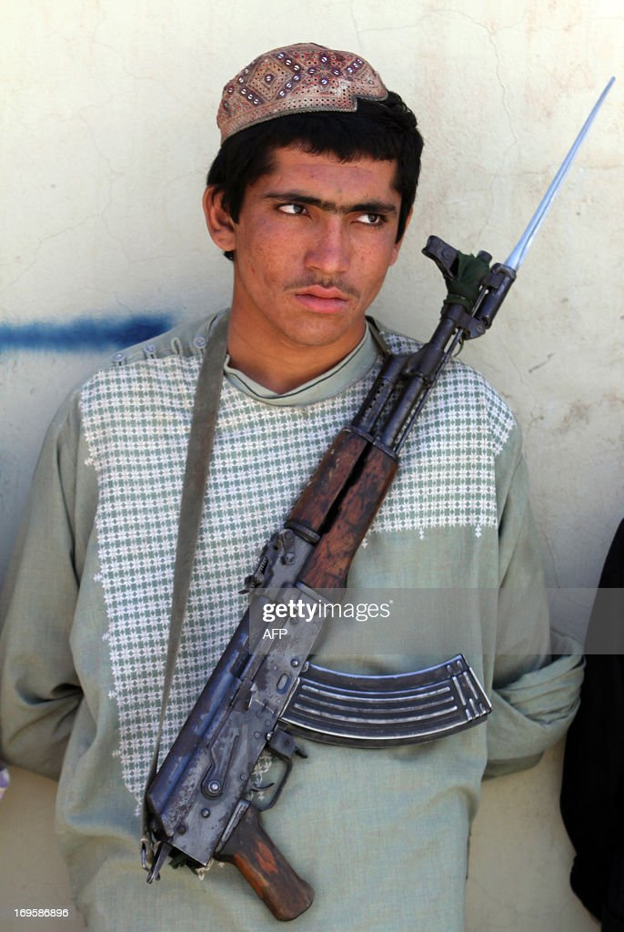 An arrested Taliban fighter is displayed to the media in Panjwai district of Kandahar province in southern Afghanistan on May 28 2013 Suspected...