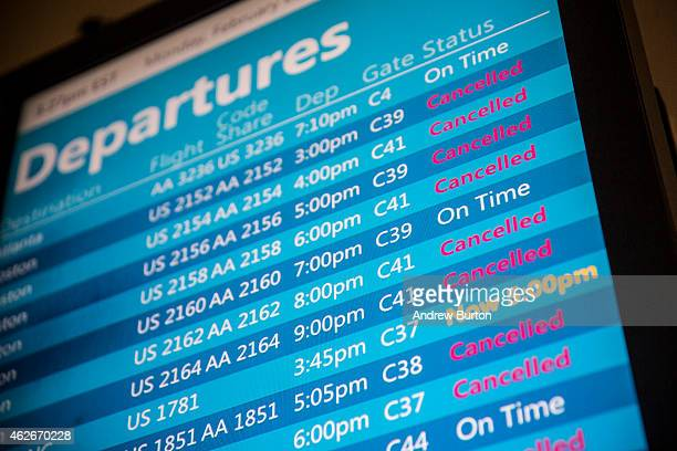 An ArrivalsDepartures screen displays cancelled flights at La Guardia Airport during a winter storm on February 2 2015 in the Queens borough of New...