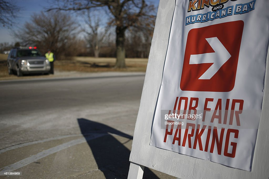 An arrow points to parking for a job fair held by Kentucky Kingdom amusement park to hire seasonal summer workers in Louisville, Kentucky, U.S. on Saturday, Jan. 4, 2014. Companies added more workers than projected in December as U.S. employers grew more optimistic about the prospects for demand, a private report based on payrolls showed Jan. 8. Photographer: Luke Sharrett/Bloomberg via Getty Images
