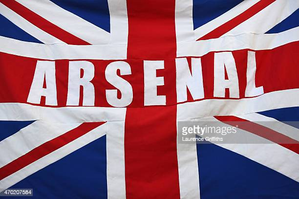 An Arsenal fan displays a Union Jack flag during the FA Cup Semi Final between Arsenal and Reading at Wembley Stadium on April 18 2015 in London...