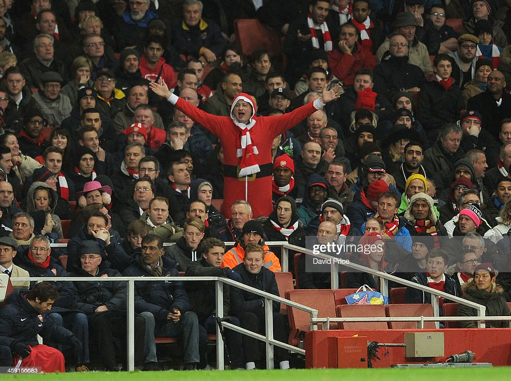 An Arsenal fan dressed as Father Christmas during the match between Arsenal and Chelsea in the Barclays Premier League at Emirates Stadium on December 23, 2013 in London, England.