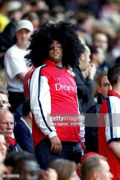 An Arsenal fan in an afro wig