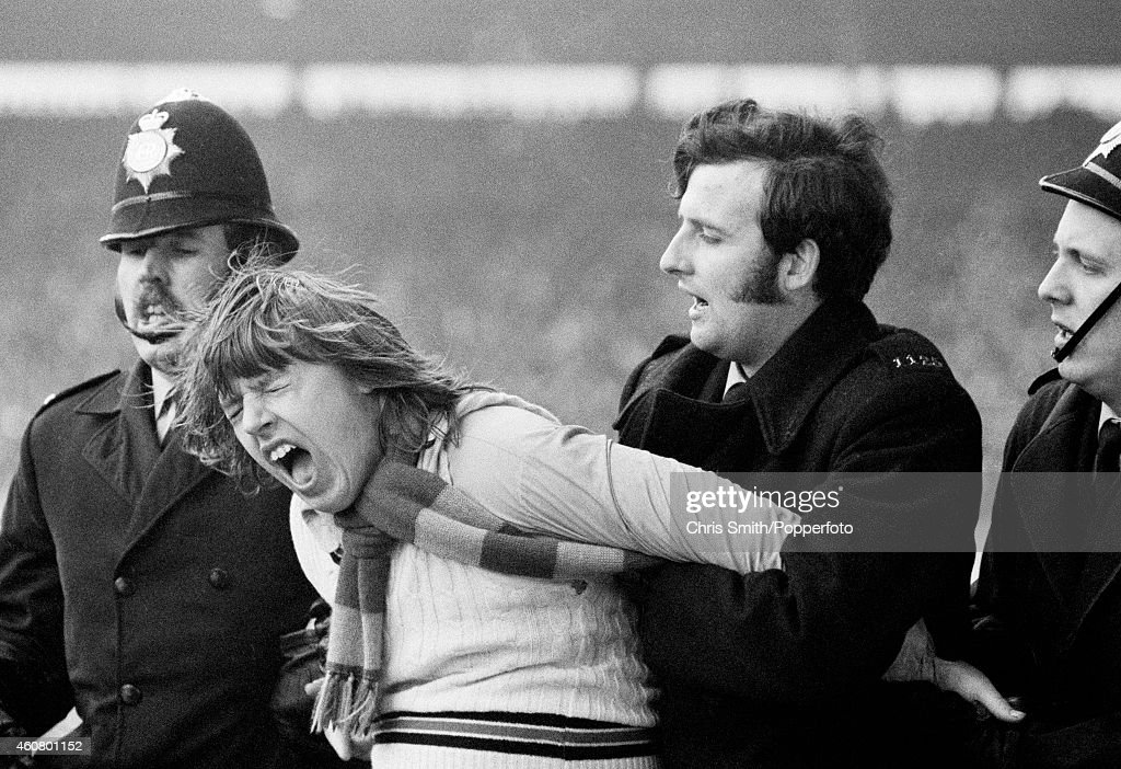 An Arsenal fan is arrested during the FA Cup SemiFinal between Sunderland and Arsenal at Hillsborough in Sheffield on 7th April 1973 Sunderland won 21