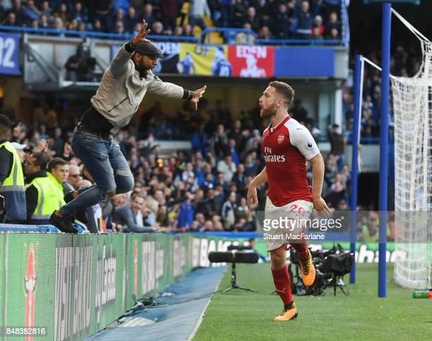 An Arsenal fan jumps onto the pitch as Shkodran Mustafi celebrates his goal which was disallowed during the Premier League match between Chelsea and...