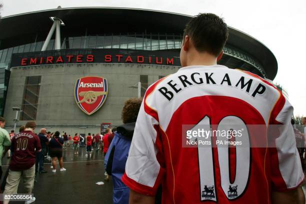 An Arsenal fan outside of the club's new Emirates Stadium before the Dennis Bergkamp Testimonial match against Ajax