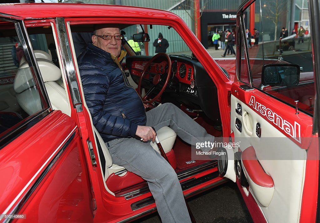 An Arsenal fan poses in his customised car prior to the Barclays Premier League match between Arsenal and Leicester City at the Emirates Stadium.