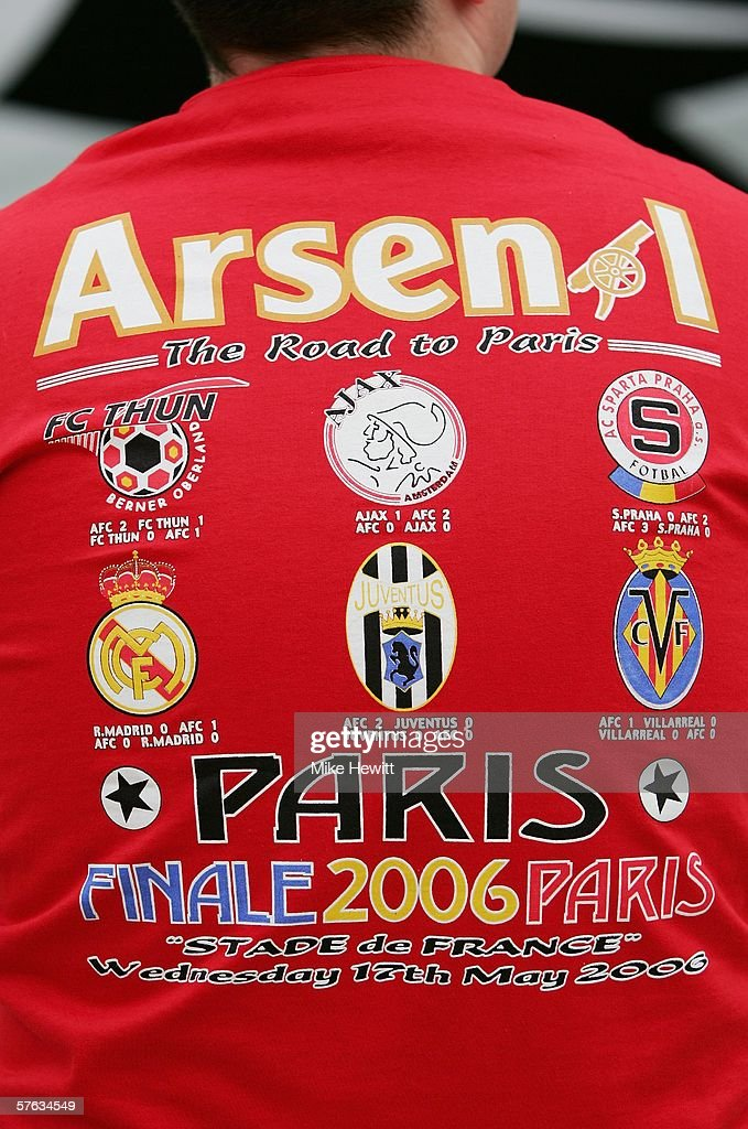 2006-2008 Arsenal Kit An Arsenal fan wears a souvenir t-shirt prior to the UEFA  Champions League Final ... bb2dd0a5f