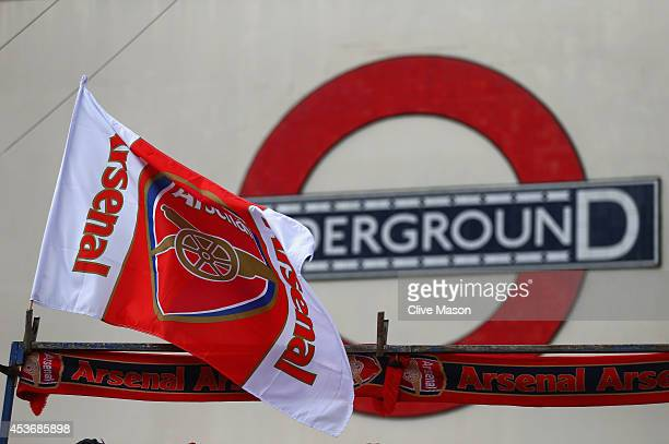An Arsenal flag flies on a street stall outside the underground prior to the Barclays Premier League match between Arsenal and Crystal Palace at...