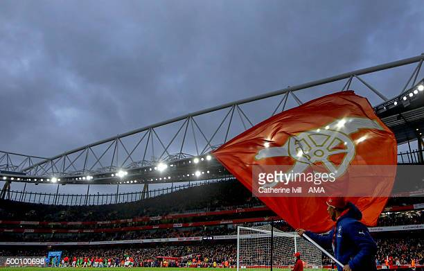 An Arsenal flag is waved as the teams come out onto the pitch before the Barclays Premier League match between Arsenal and Sunderland at the Emirates...