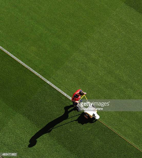 An Arsenal groundsman mark out the pitch before the Barclays Premier League match between Arsenal and West Ham United at Emirates Stadium on August 9...