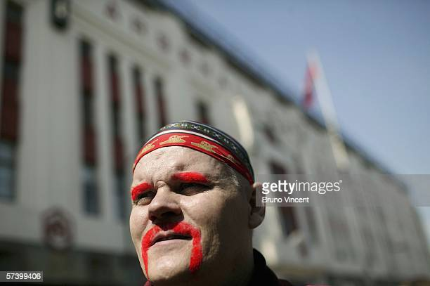 An Arsenal supporter arrives at Highbury stadium before Arsenal's penultimate match against Tottenham Hotspur before moving to their new ground on...