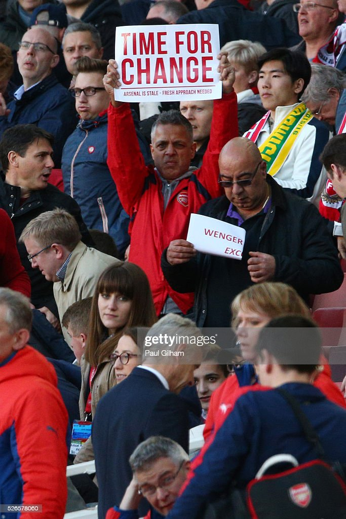 An Arsenal supporter holds a banner 'Time For Change' as <a gi-track='captionPersonalityLinkClicked' href=/galleries/search?phrase=Arsene+Wenger&family=editorial&specificpeople=171184 ng-click='$event.stopPropagation()'>Arsene Wenger</a> Manager of Arsenal walks off at the half time during the Barclays Premier League match between Arsenal and Norwich City at The Emirates Stadium on April 30, 2016 in London, England