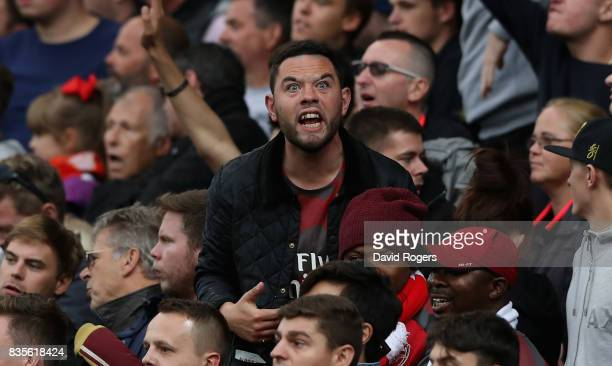 An Arsenal supporter shouts at a linesman during the Premier League match between Stoke City and Arsenal at Bet365 Stadium on August 19 2017 in Stoke...