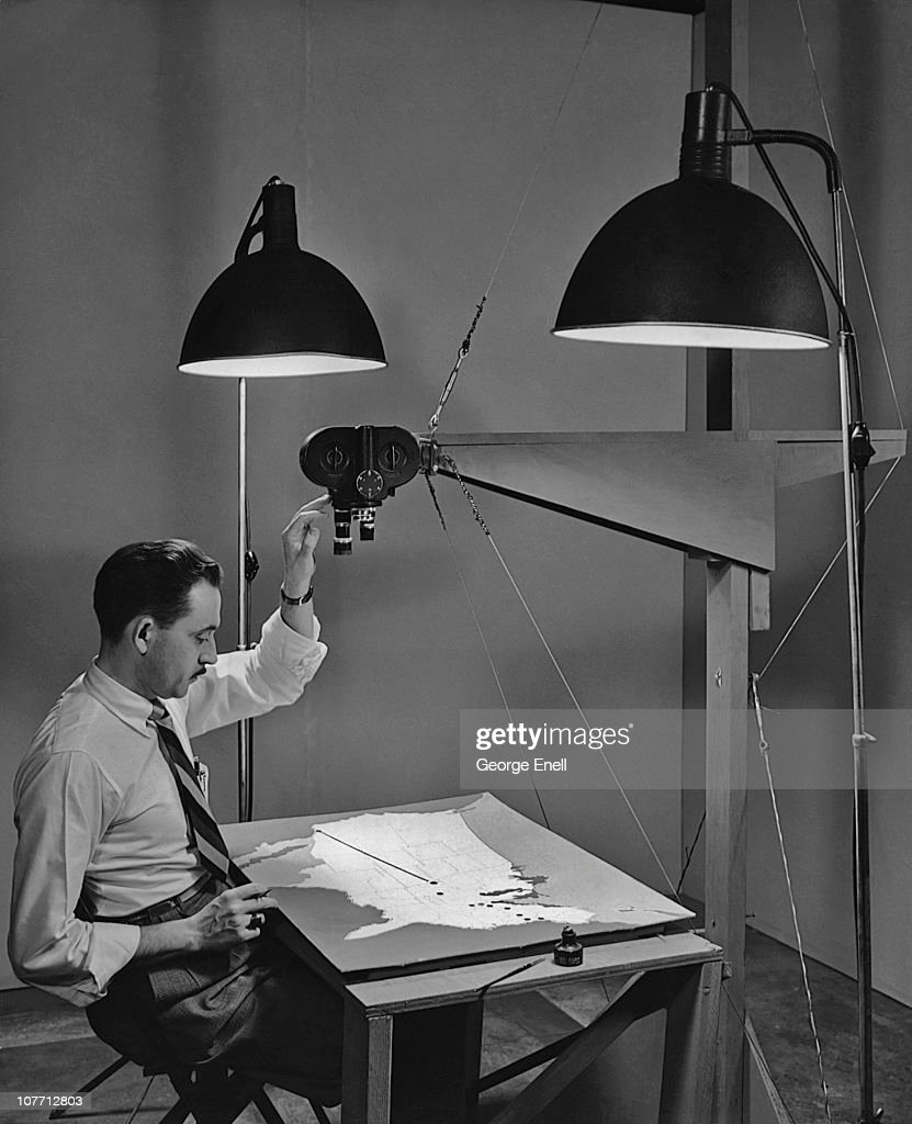An art director animating a map using motion picture studio equipment circa 1940's