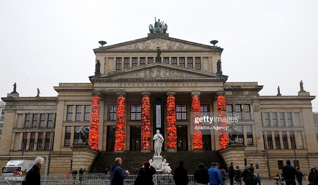 An art installation by Chinese artist Ai Weiwei showcases thousands of used life vests by refugees from the Greek island of Lesbos, on February 14, 2016 in Berlin, Germany. The orange vests are wrapped around the pillars of the city's Konzerthaus to highlight the plight of refugees trying to reach Europe .