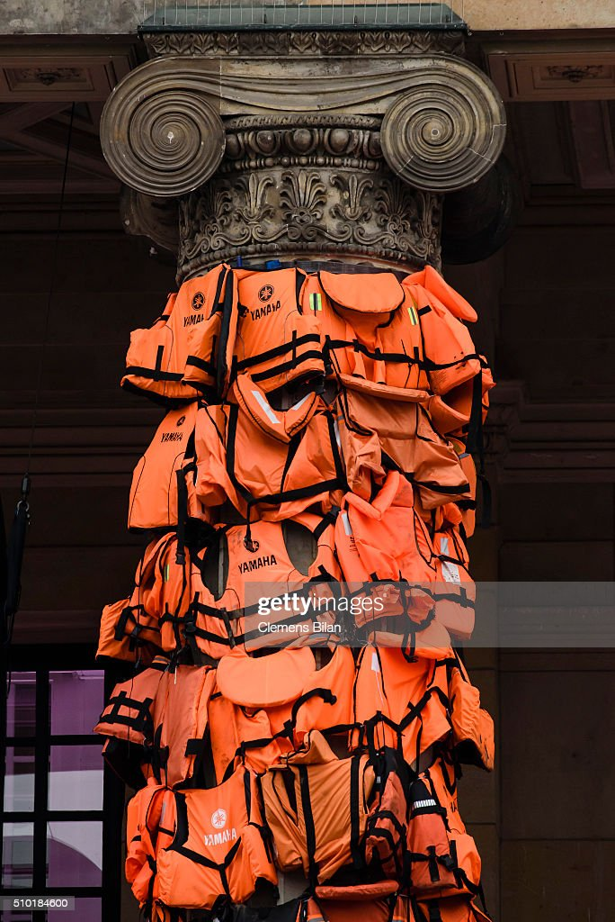 An art installation by Chinese artist Ai Weiwei that consists of life vests worn by refugees bound to the columns of the concert house at Gendarmenmarkt on February 14, 2016 in Berlin, Germany. The life vests were among the thousands discarded by migrants and refugees after they crossed the sea from Turkey to Greece. Ai Weiwei lives in Berlin and is currently involved in several projects relating to refugees. Up to 80,000 refugees currently live in Berlin and the city is preparing for the likely arrival of 30,000 more in 2016.