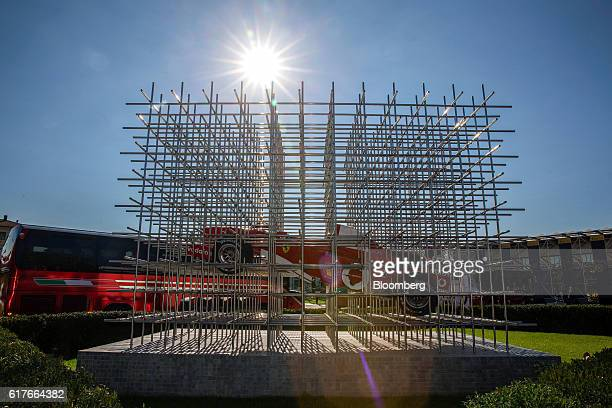 An art installation displaying a Ferrari SpA automobile stands outside the Ferrari museum in Maranello Italy on Tuesday Oct 4 2016 After Britain's...