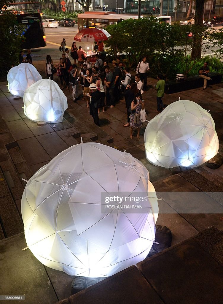 An art installation entitled 'Umbrellas' by SOTA in collaboration with Lighting Planners Associates is displayed during a media preview for the Singapore Night Festival on August 21, 2014. The seventh edition of the Singapore Night Festival, to be held over two weekends in August, will feature art installations from local and international artists and with a variety of performances. AFP PHOTO/ROSLAN RAHMAN