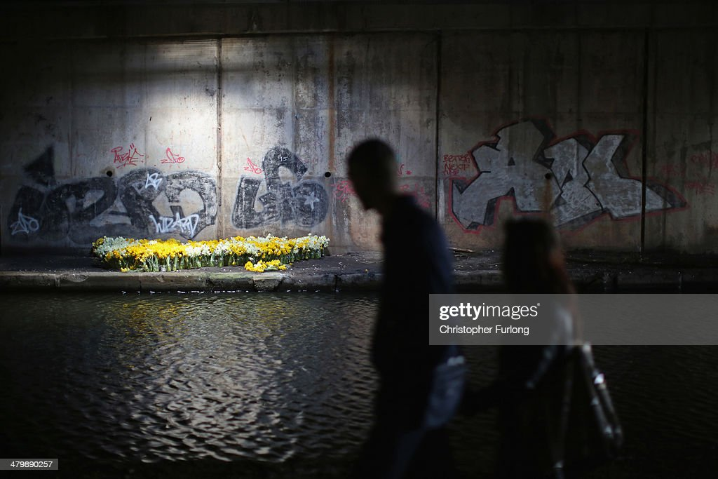 An art installation of spring daffodils sits next to the canal and graffitti deep inside the cavernous walkways underneath the M6 motorway's Spaghetti junction on March 21, 2014 in Birmingham, United Kingdom. The bed of daffodils are part of an art project by Bill Drummond, formerly of the pop band KLF, and is part of his Eastside Projects exhibition.