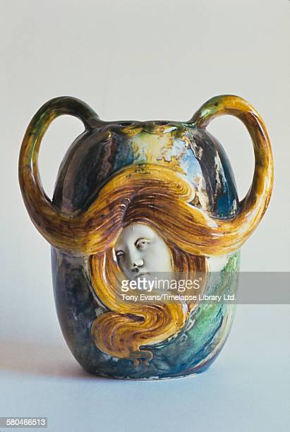 An art nouveau ceramic pot depicting a young woman with her fair hair sweeping up to form the handles circa 1970