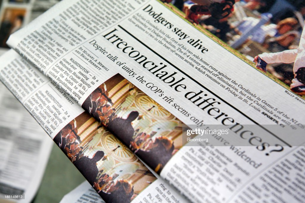 An article about the lack of GOP unity is seen on the front page of the Los Angeles Times newspaper at the Olympic Press facility in Los Angeles, California, U.S, on Wednesday, Oct. 16, 2013. Congress ended the 16-day government shutdown, raising the U.S. debt limit after the leaders of the Senate reached a bipartisan agreement to end the nation's fiscal impasse. Photographer: Patrick T. Fallon/Bloomberg via Getty Images