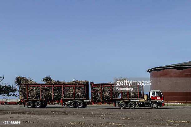 An articulated truck delivers sugarcane to the shredder at the Sezela Mill operated by Illovo Sugar Ltd in Sezela South Africa on Thursday May 14...