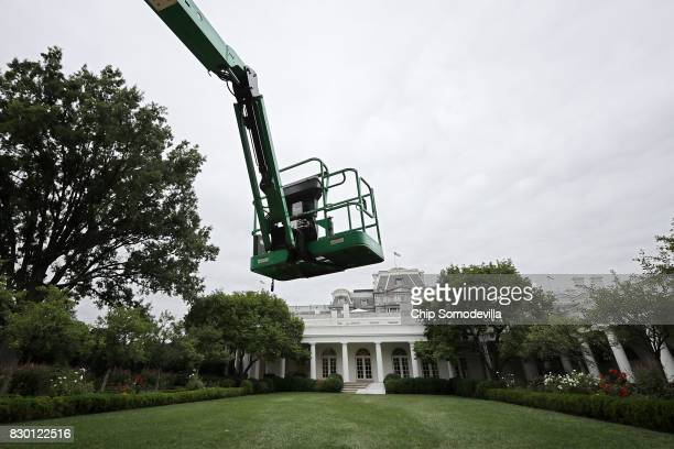 An articulating boom lift hovers over the Rose Garden during rennovation work at the White House August 11 2017 in Washington DC The Government...