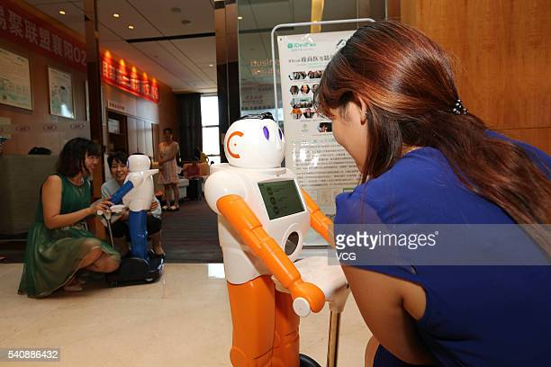 An artificial intelligent robot interacts with a customer at a technological product store on June 16 2016 in Xiangyang Hubei Province of China The...