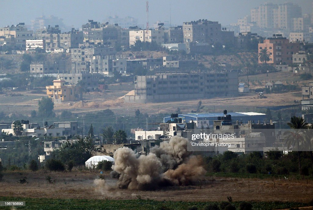 An artillery shell explodes inside the Gaza Strip on November 21, 2012 on Israel's border with the Gaza Strip. Despite widespread rumours of a ceasefire militants in the Gaza Strip continue to fire rockets and Israel continues it's bombardment. US Secretary of State Hillary Clinton has arrived in Israel to support and encourage a peace deal being brokered by Egypt.