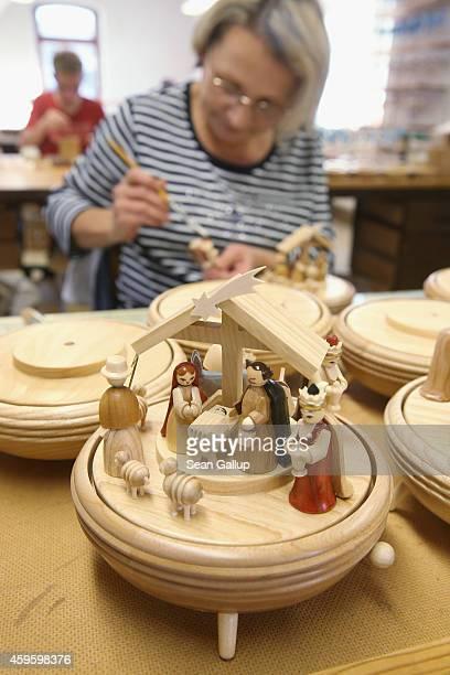 An artisan assembles handmade wooden nativity scenes at the Richard Glaesser GmbH Erzgebirgische Volkskunst ateliers on November 25 2014 in Seiffen...