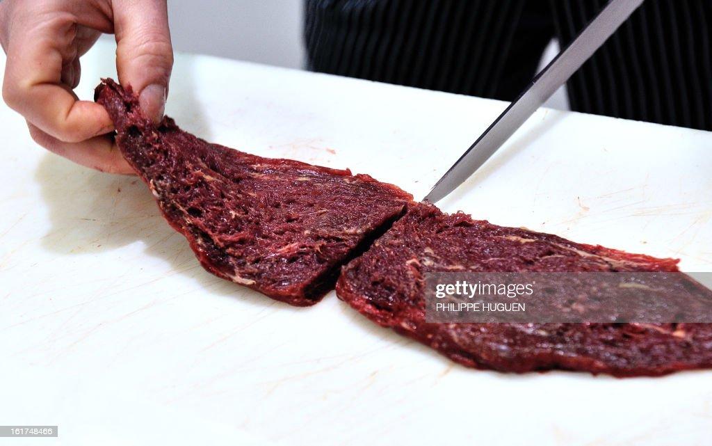 An artisan butcher cut a steak in his horsemeat butcher on February 15, 2013 in Roubaix, northern France.