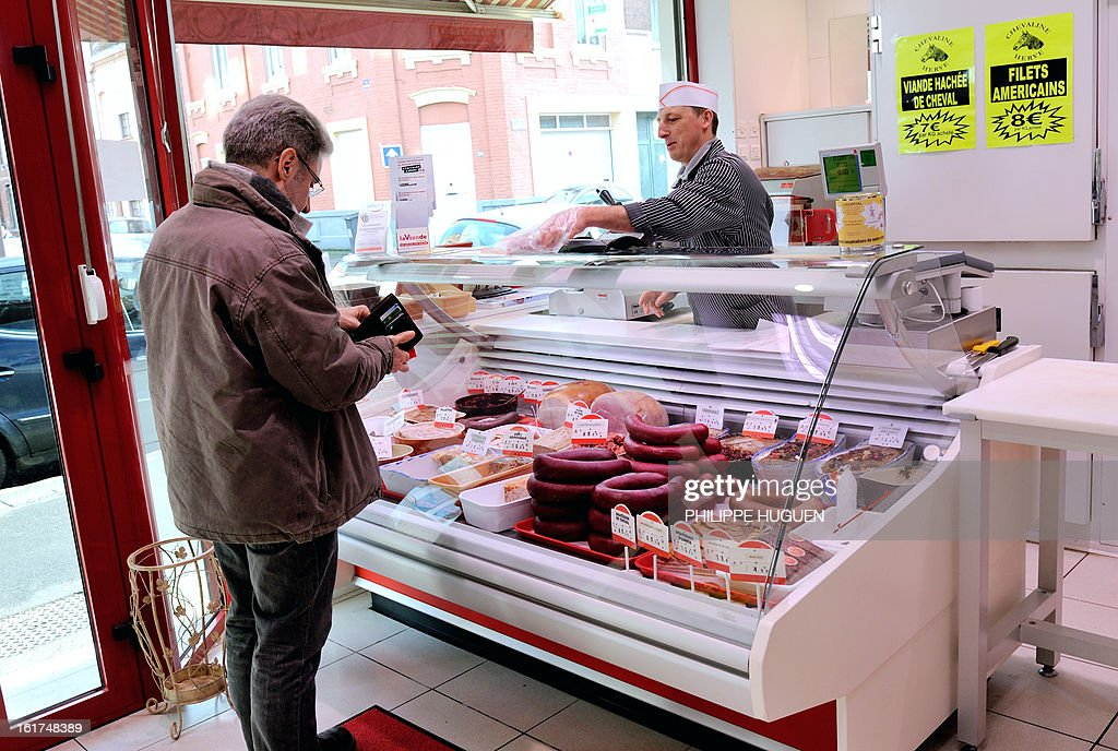 An artisan butcher works in his horsemeat butcher on February 15, 2013 in Roubaix, northern France.