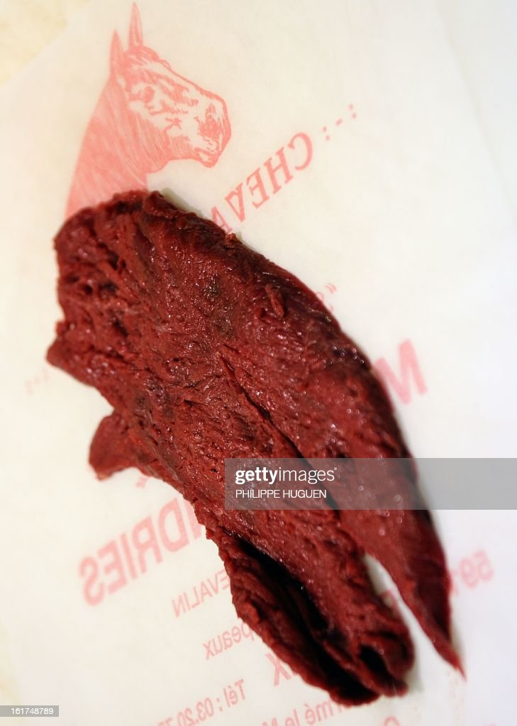 An artisan butcher works in his horsemeat butcher on February 15 2013 in Roubaix northern France AFP PHOTO PHILIPPE HUGUEN