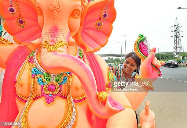 An artisan from Rajasthan works on an idol of the elephantheaded Hindu god Ganesha ahead of Ganesh Chaturthi festival at a roadside workshop on...