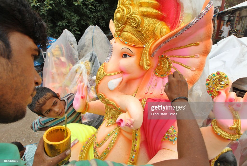 An artisan from Rajasthan, works on an idol of the elephant-headed Hindu god Ganesha ahead of Ganesh Chaturthi festival at a roadside workshop on National Highway 24 on September 8, 2013 in New Delhi, India. Ganesh Chaturthi, which begins from September 9, is celebrated as the birthday of Lord Ganesha who is widely worshiped by Hindus as the god of wisdom, prosperity and good fortune.