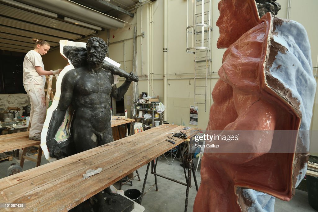 An artisan prepares a casting moulds on an original sculpture of Herkules at the Schlossbauhuette studio where a team of sculptors is creating decorative elements for the facade of the Berliner Schloss city palace on February 12, 2013 in Berlin, Germany. The Berliner Schloss was the residence of the Prussian Kaiser and was among the major architectural landmarks of Berlin until it was heavily damaged by Allied bombing in 1945. The communist authorities of East Berlin demolished the building in the 1950s, and today's Berlin government is pursuing an ambitious project to rebuild the palace according to a design by Italian architect Franco Stella, which will recreate the facade of the building but with a modern interior at a cost of approximately EUR 590 million. The Humboldt Forum, the foundation leading the project, has given the Schlossbauhuette sculptors the formidable task of recreating the hundreds of architectural elements that decorated the facade, and though some original pieces were saved, more often the sculptors have only old black and white photos as reference.