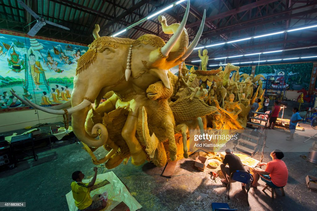 An artisans of Wat Nhong Bua Rong carve a candles for the Candle festival which will be celebrating in July 12, 2014. The Candle festival is celebrated annually on the full moon of the 8th month of the Thai lunar calendar which marks the beginning of Buddhist Lent.