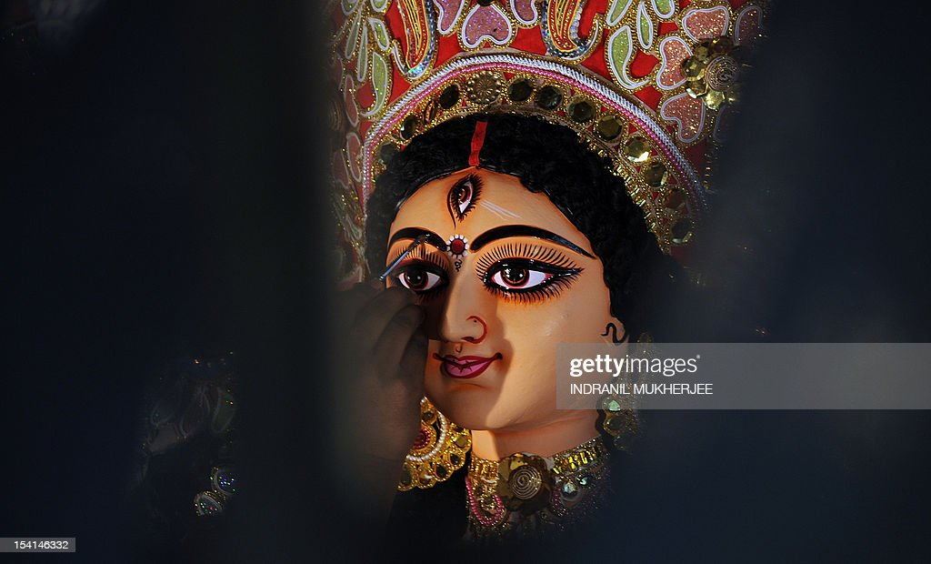 An artist applies a final coat of varnish onto an idol of Hindu Godess Durga on the last day of 'Pitrupaksh' - days for offering prayers to ancestors - at a workshop in Mumbai on October 15, 2012. In Hindu mythology this day is also called 'Mahalaya' and describes the day when the gods created the ten armed goddess Durga to destroy the demon king Asura who plotted to drive out the gods from their kingdom. The five-day period of worship of Durga, who is attributed as the destroyer of evil, commences on October 20.