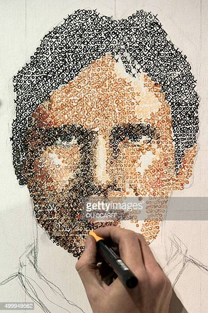 An artist creates a portrait of the Star Wars character Han Solo using naughts 'O' and crosses 'X' during the unofficial Star Wars convention 'For...