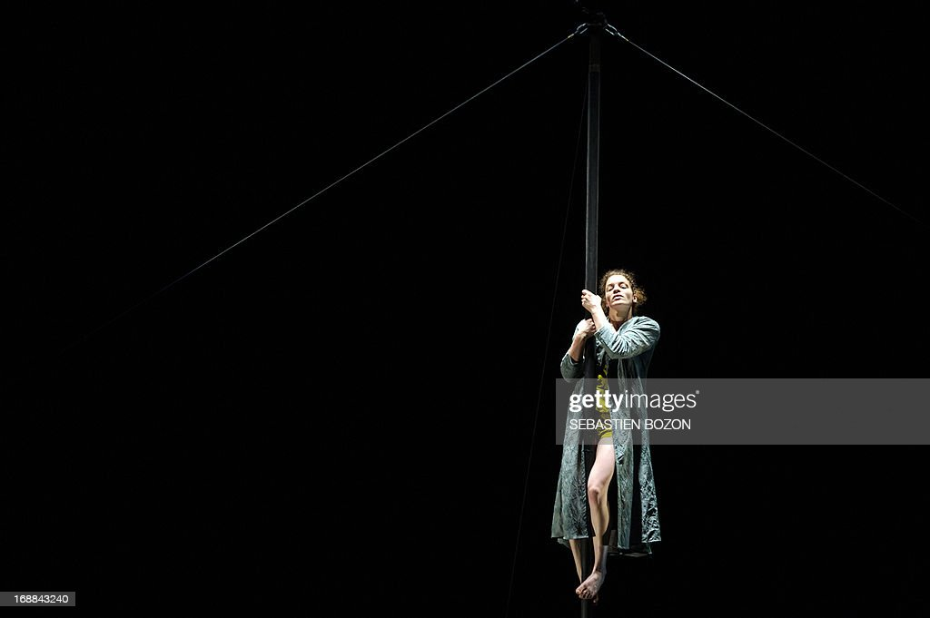 An artist from 'Le cirque Plume' company performs during the rehearsal of 'Tempus Fugit ?' show on May 15, 2013 in Besançon, eastern France. AFP PHOTO / SEBASTIEN BOZON