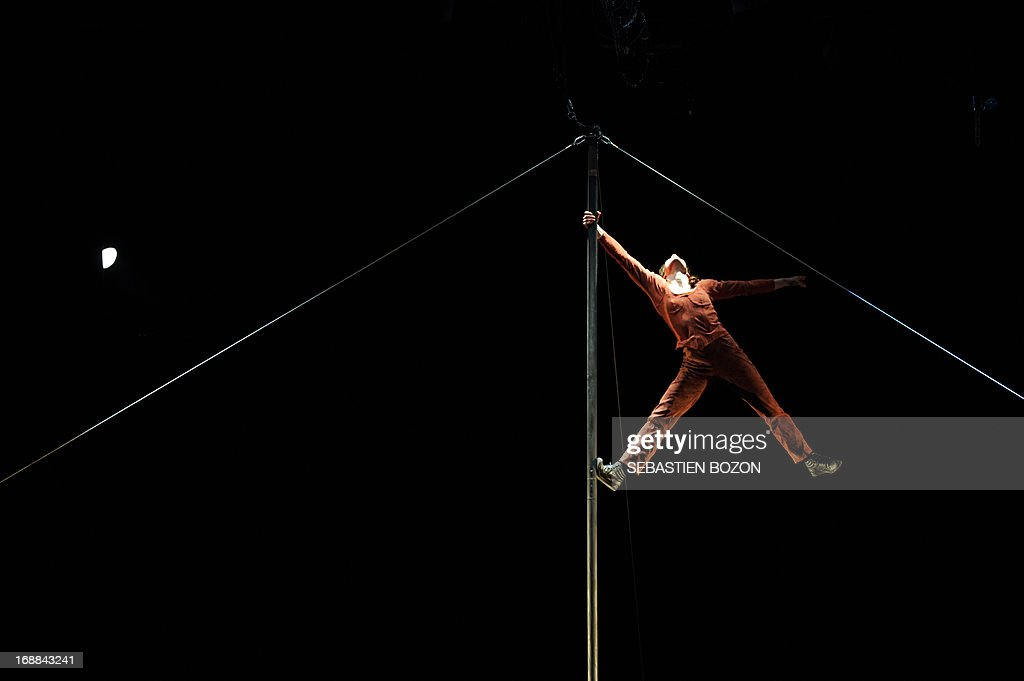 An artist from 'Le cirque Plume' company performs during the rehearsal of 'Tempus Fugit ?' show on May 15, 2013 in Besançon, eastern France.
